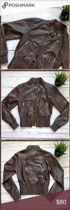 """UNIQUISM Leather Moto Jacket, brown, XS This is a beautiful real leather jacket from Uniquism New York in size XS. It's made of soft lambskin. In excellent condition.  Underarm-underarm approximately 16"""", length 20"""", sleeve inseam 19"""" and across waist 13"""". This is the perfect fall jacket!  If you have any questions, please let me know! Uniquism New York Jackets & Coats"""