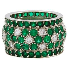 Cartier Emerald Diamond Gold Band Ring | From a unique collection of vintage band rings at https://www.1stdibs.com/jewelry/rings/band-rings/