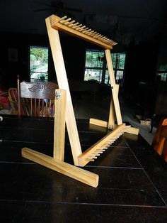 This square twining loom is 20 from corner peg to corner peg measuring across or down. The pegs extend out 1-1/2, at a 1 spacing. As you fill in the weft from each end to the middle, you can switch which end is up by pivoting the frame on the stand. The bottom is now the top but
