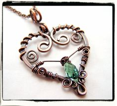 hammered wire heart, wrapped in smaller gauge wire, with suspended gem - LOVE the overall look, i think I'd change out the gem.