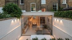 Moxon Architects gutted and redesigned its interior and added a small rear extension with open-plan living areas and a sunken garden. Victorian Terrace House, Victorian Townhouse, London Townhouse, London House, Victorian Homes, Modern Townhouse, London Apartment, Delta Light, British Architecture