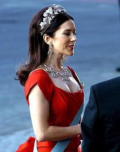 Mary wore the Ruby Parure Tiara for the second time at this pre-weddding gala on the night before her wedding, and this is still one of my favorite tiara moments of hers. The cut of the dress is perfect for the parure, and the hair is fun and lovely at the same time.  Gorgeous!
