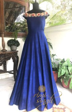 """""""You are a light. And when you shine , you shine bright."""" Midnight blue off shoulder, floor length gown in pure raw silk zardozi embroidery. Available exclusively at Rimi Singh Studio A 999 Sushant Lok 1 Gurgaon Indian Gowns Dresses, Prom Dresses, Dress Prom, Pretty Dresses, Beautiful Dresses, Reception Gown, Western Dresses, Western Gown, Anarkali Dress"""