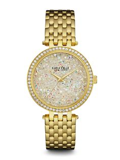 44L184 WOMEN'S WATCH PRICE $130.00 AT CLAUDIA'S JEWELRY INC.Hey, gorgeous, it's your time to shine! 60 individually hand-set crystals. Stainless steel gold-tone case and bracelet. Gold crystal dial. Fold-over buckle closure. Case Diameter: 38 mm Case Thickness: 8 mm Water Resistance: 30M