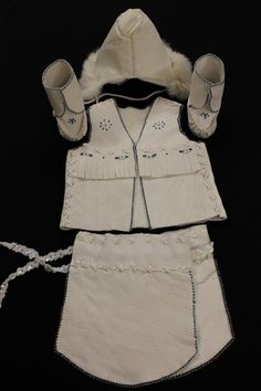 $199.95 White christening outfit made of moose hide, rabbit fur, and blue and clear beadwork. Includes fur trimmed hat, Moccasins, vest, and breechcloth by Osawamick's Wingush Crafts. #Native #NDN