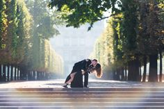 Beautiful engagement photo session in a summer morning in front of Louvre museum