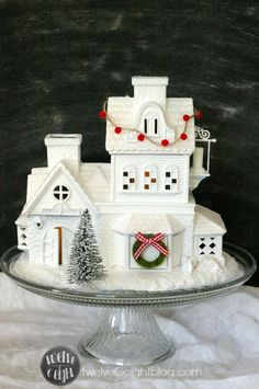 Christmas Village repainted. White spray paint, modge podge, glitter