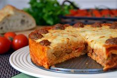 Spaghetti and Meatball Pie makes one 9-inch springform pan, serves 8-12  Filling: 1/2 pound leftover cooked spaghetti 1 1/2 - 2 cups le...