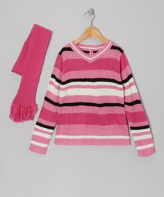 Coordinate with cozy comfort by dressing little ones in this delightful duo. Boasting a stylishly striped v-neck sweater and a tassel-trimmed scarf, it's the perfect look for keeping cuties warm and toasty.