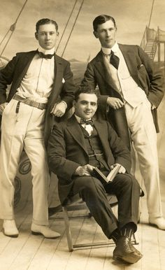 +~+~ Antique Photograph ~+~+  Portrait of smartly dressed men on a faux boat backdrop.