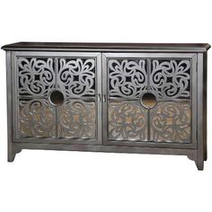 Mirrored furniture is really big right now. If the full mirrored effect is too much for you, try this grey credenza. The cut-out front tames the shine of the glass. Paige's Picks from RC Willey