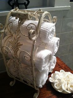 Beautiful old wine rack repurposed as towel holder.