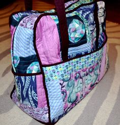 Amy Butler Weekender Bag using Tula Pink Birds and the Bees fabric.  Blog has several tips for construction!  Phone Home Designs by E.T.