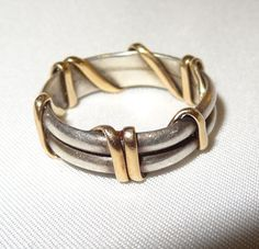 http://www.etsy.com/listing/128566871/vintage-handmade-14k-white-and-yellow?ref=br_feed_13