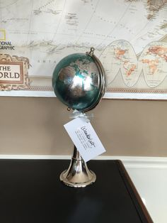 This gorgeous 19 1/2 tall turquoise and silver globe is the most stylish way to display travel pins! Comes with plenty of pearl stones to mark all of your world travels! Display all the places youve been in an easy to see display