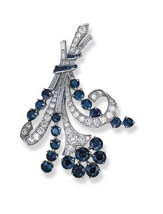 A SAPPHIRE AND DIAMOND FLORAL BROOCH, BY TIFFANY & CO.   Designed as circular-cut sapphire stylized flowers to the circular and baguette-cut diamond stems, mounted in platinum  Signed Tiffany & Co.