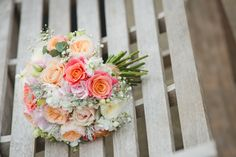 Coral wedding bouquet at Staffordshire wedding venue Packington Moor.