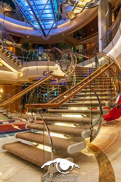 Stay active while on your cruise by taking the stairs. Freedom of the Seas' staircases offer a beautiful and easy way to keep moving.
