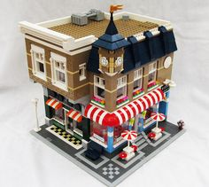 ice cream shop with music and book stores (love the detail of the air units on the roof)