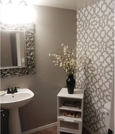 stencil over wallpaper - powder room painted walls