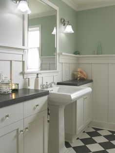 source: Goforth Gill Architects  Cottage bathroom with sage green walls paint color, board and batten walls, glossy white pedestal sink flanked by ivory overlay cabinets and black & white checkered floor. http://activelifeessentials.com/for-the-home/ #homedecor