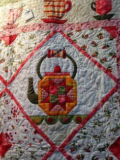 Garden Tea Party quilt at the Maywood Studio booth, 2014 Fall Quilt Market. Pattern by The Quilt Company. Closeup photo by The Quilting Queen Online