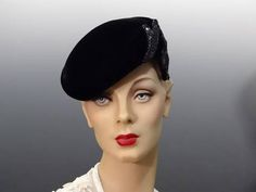 Vintage black velvet pillbox hat 1950s womens formalwear cocktail party. Condition is very good. No notable blemishes! Hat has been very well preserved and looks as if it has never been work. Perfect hat for After Five, opera, ballet, theatre and all your special events. Hat measures 22 inches around the interior band. Lovely black lace lining, and the beadwork is a gorgeous silver charcoal color. To look through all my hats and fascinators: https://www.etsy.com/shop/Su...