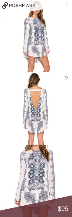 Free People Smooth Talker Tunic Dress Roam the streets while on casual outings in this sexy printed crepe tunic by Free People with a ruffled hem and low V-back with strap detail. Free People Dresses Mini