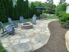 Flagstone patio and fire pit by Wildwood Land Design.