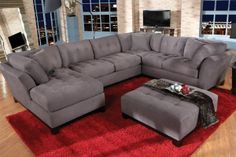 The Cadillac Collection is where style meets comfort. Durable gray microfiber, modern tufting details, flared arms, an exposed wood frame, and 8-way hand-tied springs all come together for the perfect place for you to relax (and look good doing it!).