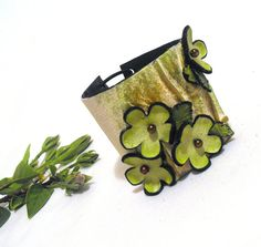 Green leather bracelet with flowers and leaves by julishland, $19.00