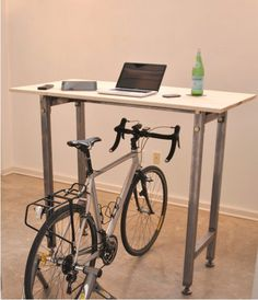 The kickstand desk. Ride your bike then stick it at your desk and keep peddling. Get exercise and someplace tho store your bike! Looks like it could be used as a stand-up desk when the bike's not there. Atelier Home, Treadmill Desk, Bike Trainer, Stand Up Desk, Diy Desk, My New Room, Declutter, Cool Stuff, Decoration
