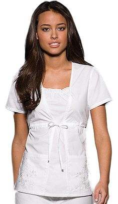 Get an elegant look with this solid scrub top from Cherokee Uniforms. It features a shaped front seams with a center front inset that provides this top its two-piece look. (This item is out of stock at this time) Cherokee Uniforms, Cherokee Scrubs, Scrubs Outfit, Scrubs Uniform, Medical Scrubs, Nurse Scrubs, White Scrubs, Empire Waist Tops, Nursing Accessories