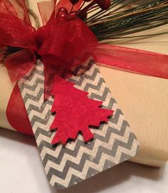 each member of the family gets their own shape for their gifts and can reuse every year.  (felt christmas tags)