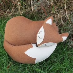 Brown fox. A snoozy fox cushion made from textured wool. 38cm in length. £32.00
