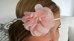 This beautiful handcrafted baby headband features a 3 chiffon flower in peach on a 1/8 white elastic. Perfect for photo props, special