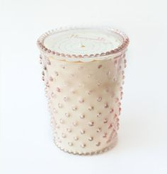 Beautiful hobnail glass in many lovely colors and filled with pure vegetable wax. These candles will burn up to 100 hours as they fill your space with fragrant illumination. These glasses are handcrafted, variation in glass color will occur. 16 oz. A heady floral mimicking its namesake with warm, sweet honey & herbaceous flowers.