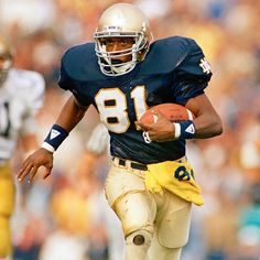 "Tim Brown # 81 Notre Dame Fighting Irish WR. Like the Irish? Be sure to check out and ""LIKE"" my Facebook Page https://www.facebook.com/HereComestheIrish Please be sure to upload and share any personal pictures of your Notre Dame experience with your fellow Irish fans!"