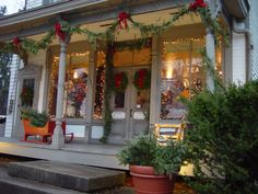 Old-fashioned country Christmas. Im loving the homemade pine garland. I must make.lol