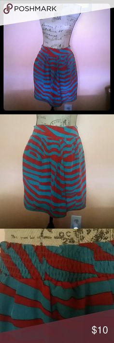 Fabulous Silky Zebra Print Skirt by Francesca's Adorable zebra print loose fit miniskirt from Francesca's Collections. Silky fabric with teal and brick red print. Fully lined,  elastic waist back. Has cute side pockets. Size S (runs a little loose,  so may fit M). Francesca's Collections Skirts Mini