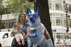 More than 100 fiberglass dog statues will be on display on Michigan Avenue through Labor Day to benefit the Chicago Police Memorial Foundation and PAWS Chicago.