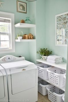 Love the shelves for the laundry baskets. Love the color on the walls too!