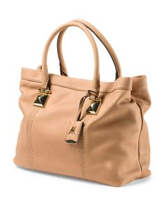 Real leather and great price $69), had to order it ;) Dakota Leather Tote With Studs