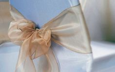 gold organza chair sashes on white chair covers