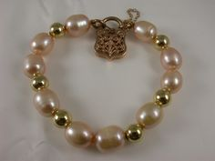 Charming apricot coloured cultured #Pearl #bracelet with yellow gold beads  9ct Rose #Gold Pad-lock style clasp  $695 #locket
