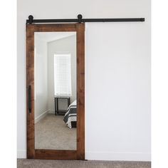 This Mirror Door makes a great option for a bathroom or closet. The mirror design offers a feeling of a bigger, more spacious, room for those tight situations. The included industrial top mount track