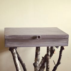 OMG - this is a MUST HAVE. A box table with branches as the legs. I am totally in love with this.