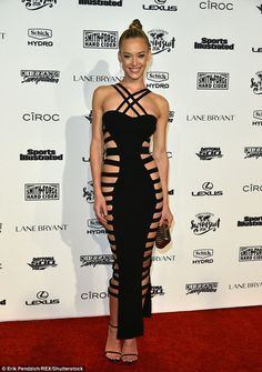 Cut it out! Hannah Ferguson turned heads in a revealing black dress that had a cut-outs along the sides