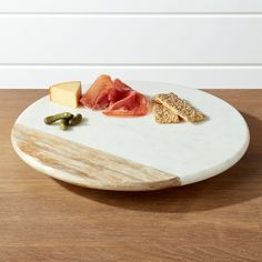 Shop Wood and Marble Lazy Susan. A masterwork of natural materials, this offset arrangement of white marble and mango wood crafts an elevated Lazy Susan for serving charcuterie and crudités or storing spices and condiments. Crate And Barrel, Storing Spices, Best Housewarming Gifts, French Kitchen, Knives And Tools, Charcuterie Board, Crates, Fruit, Kitchen Gadgets