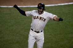 Description of . San Francisco Giants' Michael Morse (38) celebrates after connecting for a solo home run in the 8th inning against the St. Louis Cardinals in Game 5 of the National League baseball championship series at AT&T Park in San Francisco, Calif., on Thursday, Oct. 16, 2014. (Jose Carlos Fajardo/Bay Area News Group)